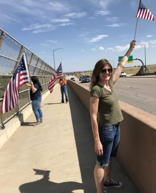 """Yesterday I went to hold an American flag on a highway overpass to commemorate 9/11..I waved at the people in their cars as they drove by. .Some waved back and smiled. Others honked. Others yelled excitedly in support..Some yelled at me. Others cursed at me. Others gave me the finger. Still others pretended not to see me as if I didn't exist..I smiled even bigger and sent even more love their way..I wasn't holding a Democratic, Republican, liberal, rich, poor, conservative, black, white, Native American,, Latin American, Asian, Russian, Middle Eastern, Jewish, Christian, Muslim, Hindi, Buddhist, or Atheist flag..You see - it wasn't ONE of those. It was ALL of those and more..This country was founded on the principles of freedom, hard work, strong morals and ethics, citizenship; the right to believe whatever you want, the right to work, education, liberty. .That is what the flag stands for..And many, many, many men and women have died fighting for those values.In the US, we have forgotten who we are..No one is born hating someone for their beliefs, their skin color, their religion, their socioeconomic status, or their political party. .Hatred is learned. Hatred is taught. By parents, friends, the educational system, religious institutions, and the government. It is then reinforced by the media..I couldn't help feeling sad for the people who cursed at me. .I thought about the example those people were living and giving their children - if someone doesn't agree with you or holds different beliefs - curse them, yell at them, attack them, even hurt them physically. That is how you deal with differences..Not have a civil dialogue to discover why they believe what they do, try to understand them, be curious instead of critical. .From Luke 6:28, """"bless those who curse you, pray for those who mistreat you.""""""""Hate cannot drive out hate; only love can do that."""" Dr. Martin Luther King, Jr..We all have more similarities than differences, despite what political parties, mainstream"""